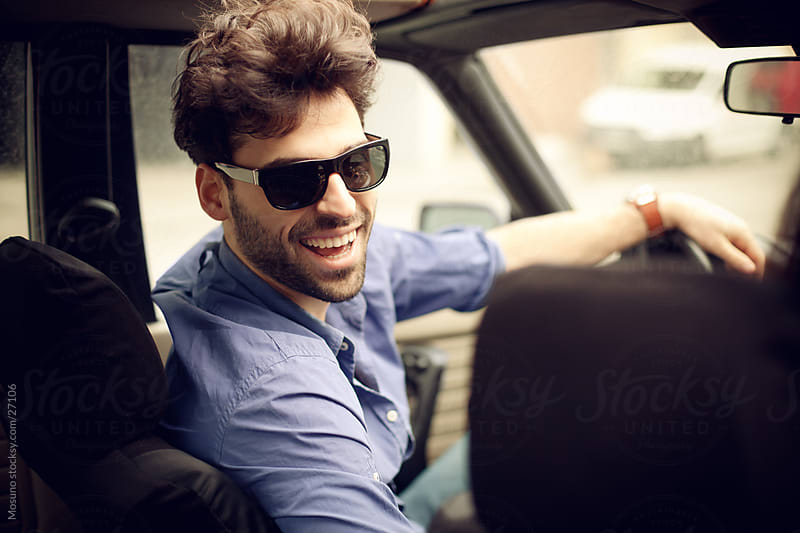 Handsome man driving convertible car. by Mosuno for Stocksy United