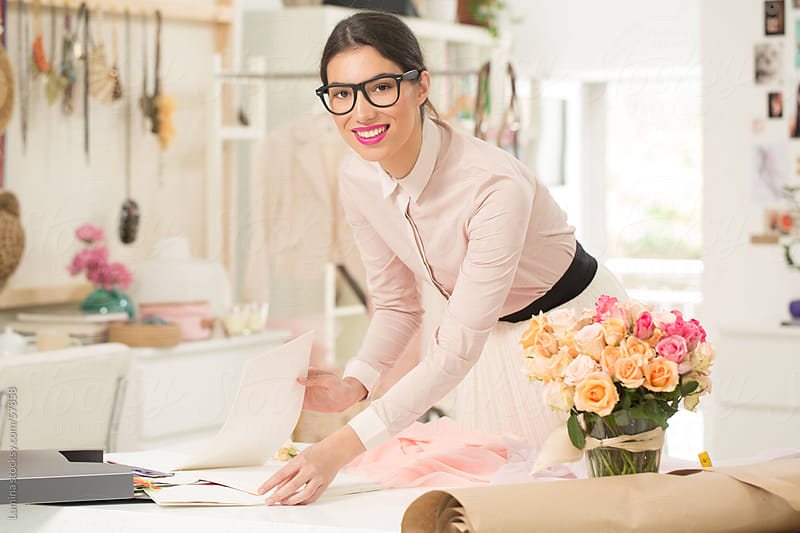 Smiling Fashion Designer at Work by Lumina for Stocksy United