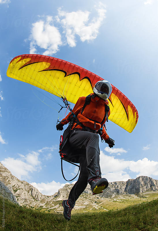 Paraglider taking off from the ground by RG&B Images for Stocksy United