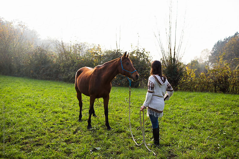 Woman communicating to her horse by michela ravasio for Stocksy United