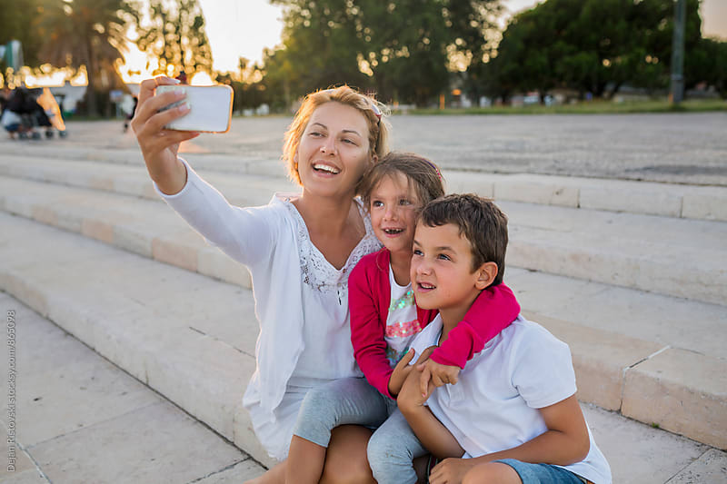 Family taking selfie with mobile phone. by Dejan Ristovski for Stocksy United