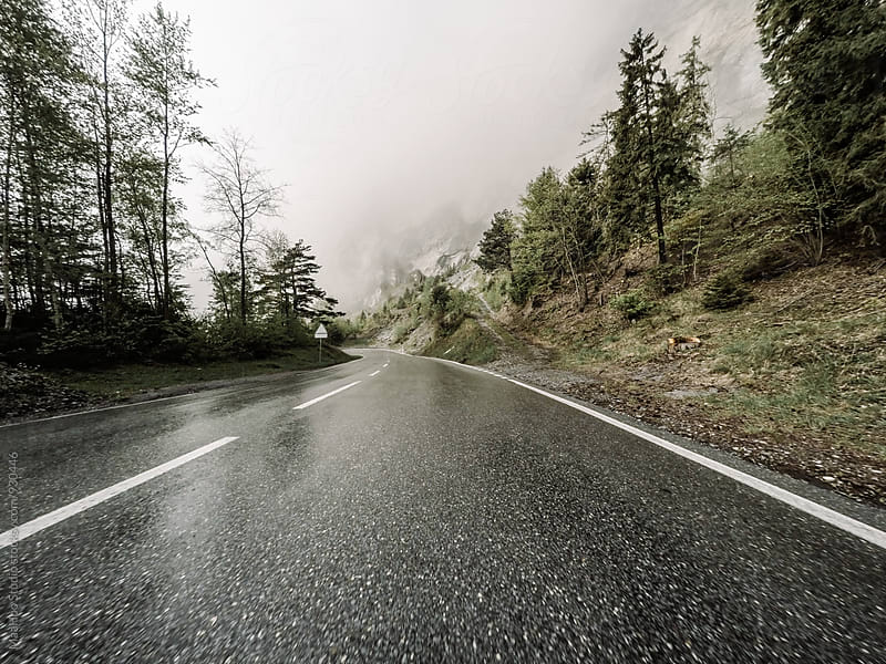 Drive crossing the Alps mountains by Maa Hoo for Stocksy United