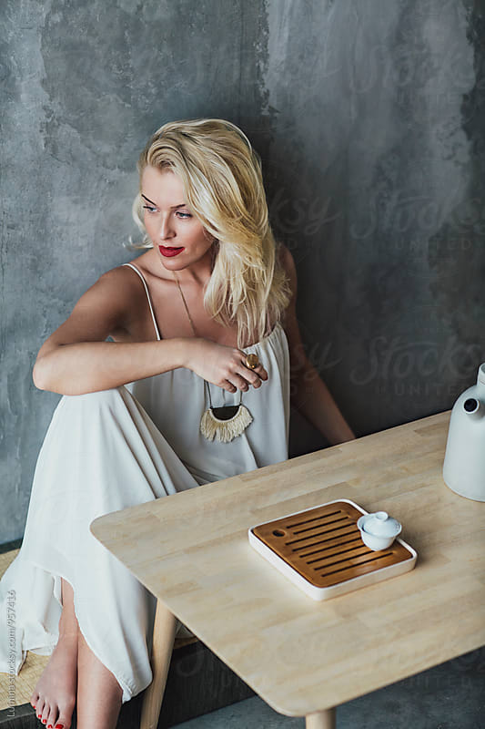 Woman Drinks Tea by Lumina for Stocksy United