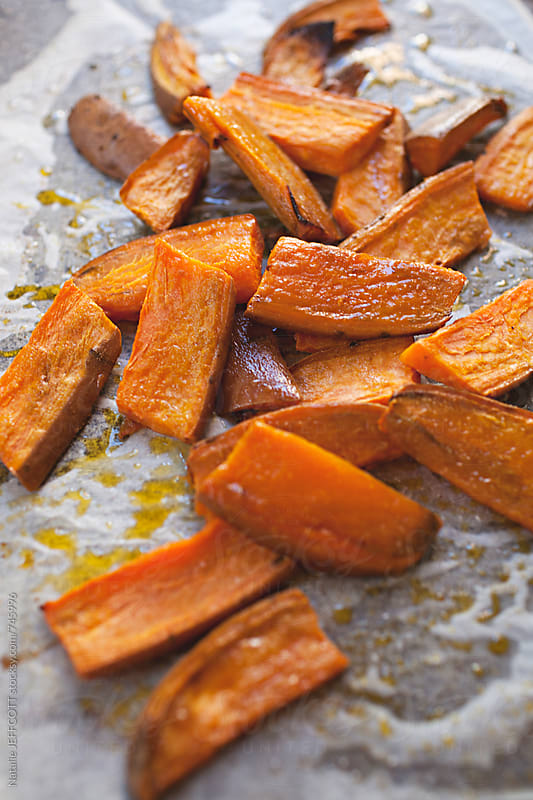 roasted sweet potato wedges by Natalie JEFFCOTT for Stocksy United
