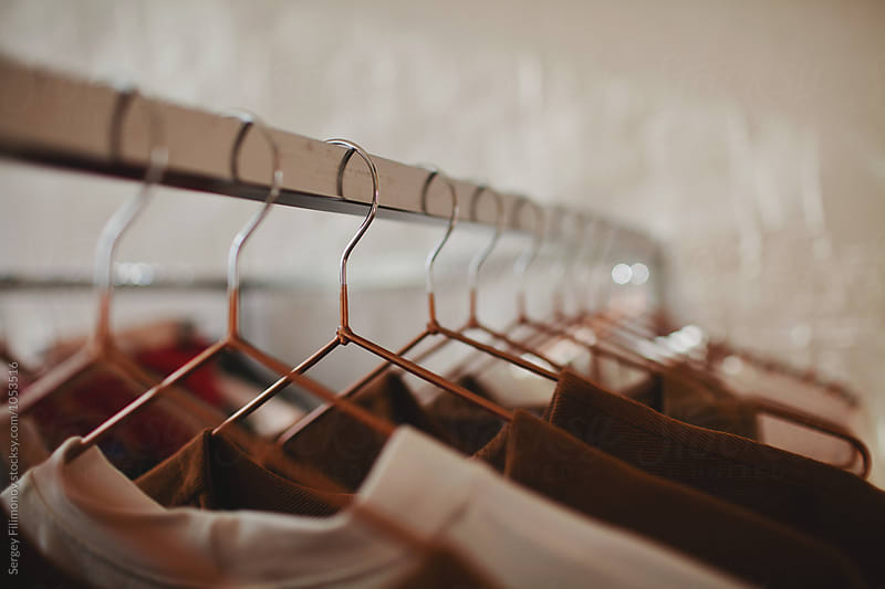 Hangers at a clothing store by Sergey Filimonov for Stocksy United