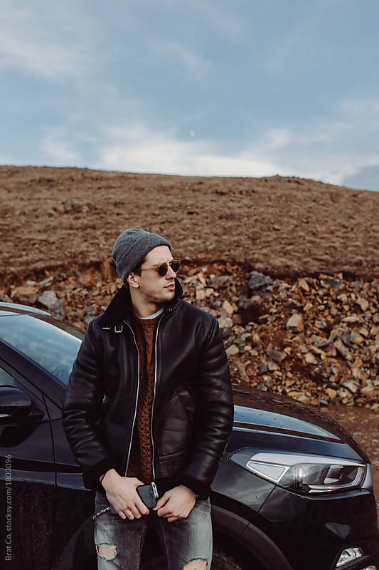 Stylish Young Man Standing In Front Of His Car By Brat Co. For Stocksy  United