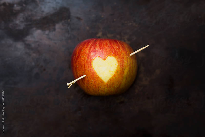Valentine apple on a black background by Jovana Rikalo for Stocksy United