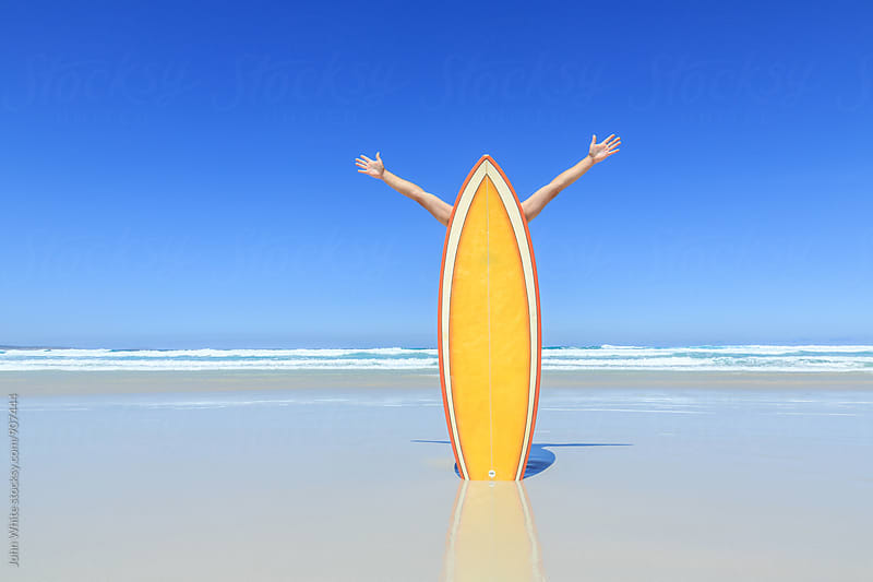 Surfboard with arms reaching for the sky. by John White for Stocksy United