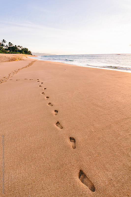 Footprints on the beach of tropical island by Alejandro Moreno de Carlos for Stocksy United