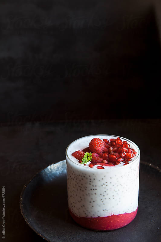 Chai seed, pomegranate and raspberry breakfast by Nadine Greeff for Stocksy United