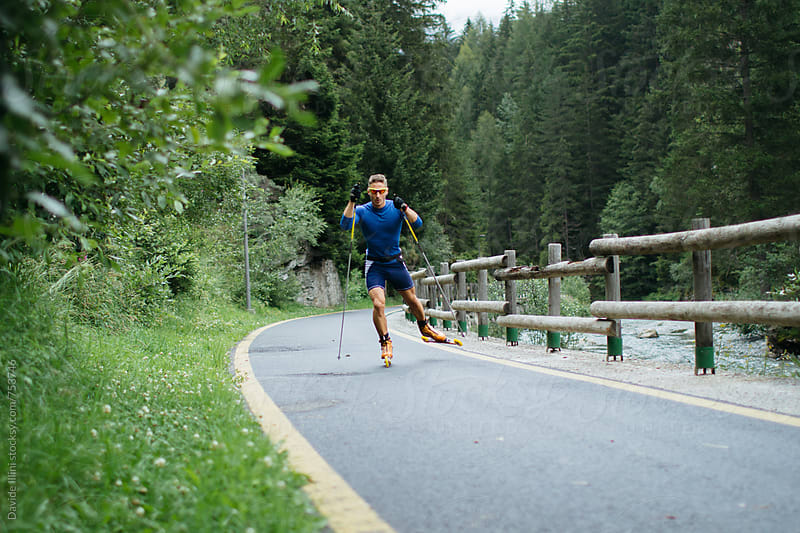 Athlete practice cross-country skiroll by Davide Illini for Stocksy United