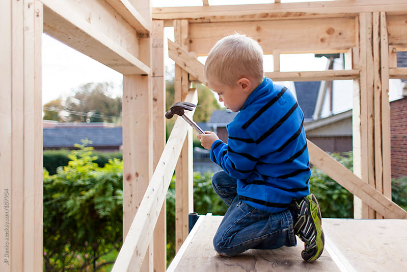 Little Boy Framing Contractor Building a House by JP Danko for Stocksy United