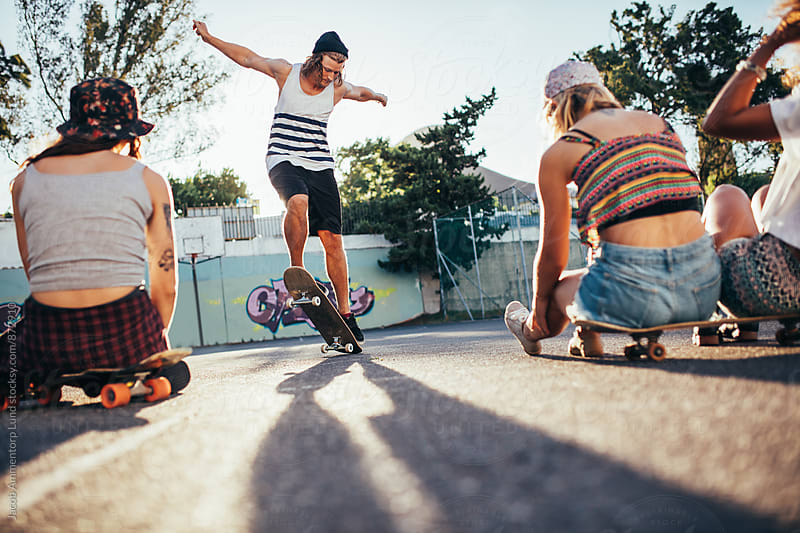 Young people having fun at the skateboard park by Jacob Ammentorp Lund for Stocksy United
