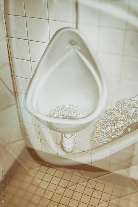 Double exposure of a flushing urinal by Marcel for Stocksy United