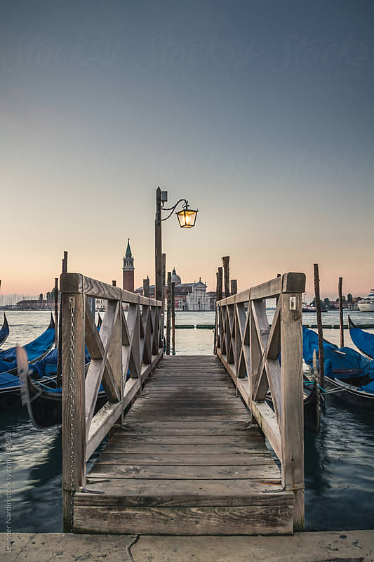 View from a dock to the island San Giorgio Maggiore  by Leander Nardin for Stocksy United