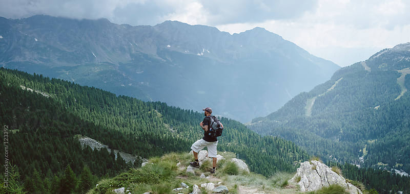 Man watching nature in mountain by GIC for Stocksy United