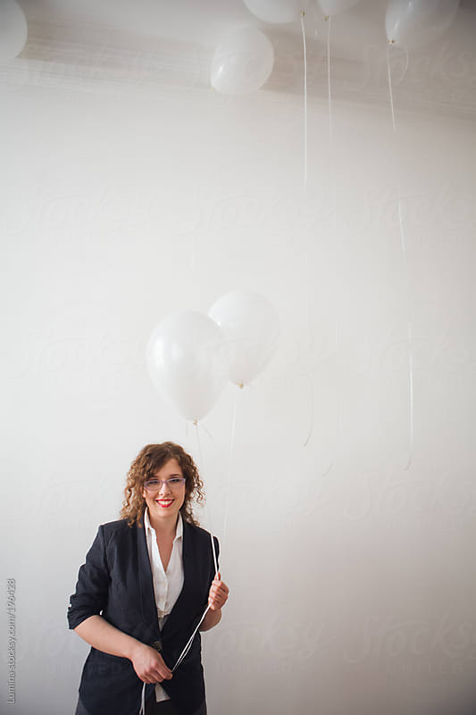 Woman Holding White Balloons by Lumina for Stocksy United