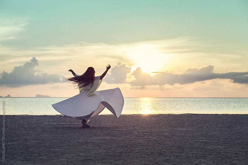 Woman Dancing on the Beach at Sunset by VISUALSPECTRUM for Stocksy United