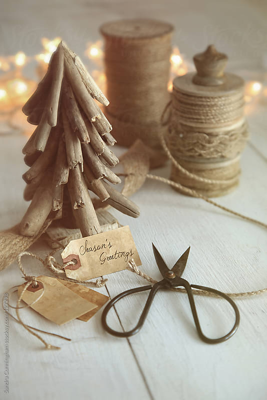 Wooden tree with rustic twine and cord for wrapping gifts by Sandra Cunningham for Stocksy United