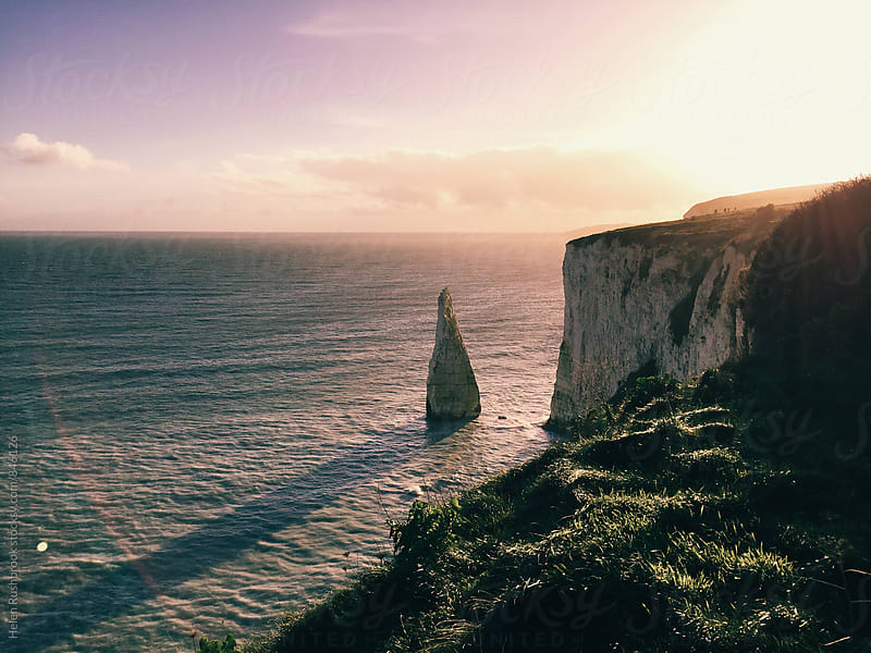 Late afternoon sunshine on the Dorset coast by Helen Rushbrook for Stocksy United