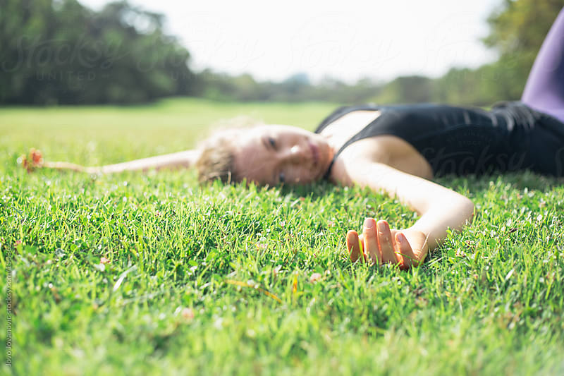 Relaxing on green grass.  by Jovo Jovanovic for Stocksy United