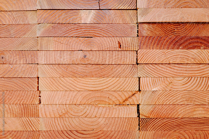 Stack of lumber used for construction by Paul Edmondson for Stocksy United