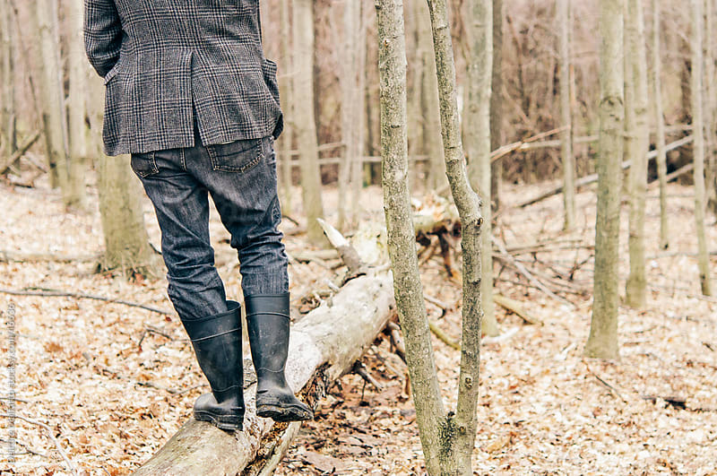 Back of man walking through woods, from behind by Deirdre Malfatto for Stocksy United