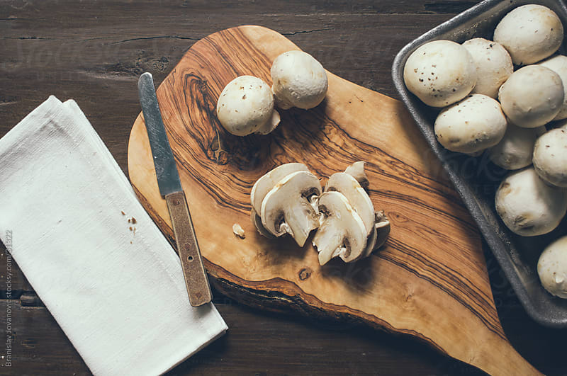 Preparing mushrooms for cooking by Branislav Jovanović for Stocksy United