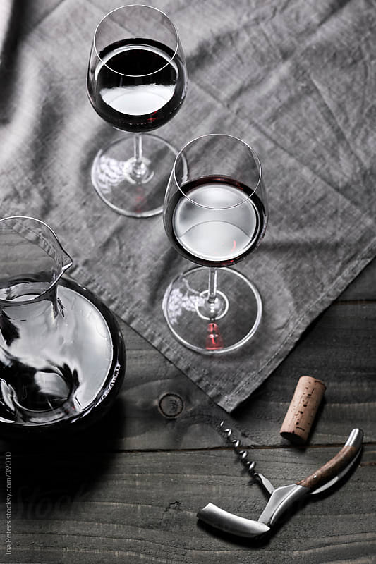 Wine: Two glasses of red wine, decanter and corkscrew by Ina Peters for Stocksy United