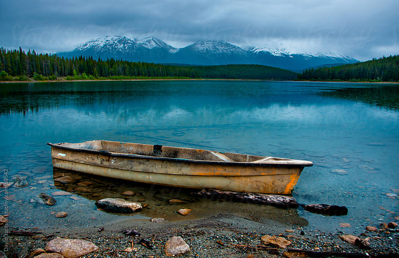 Boat in the Mountain Rain by David Jackson for Stocksy United