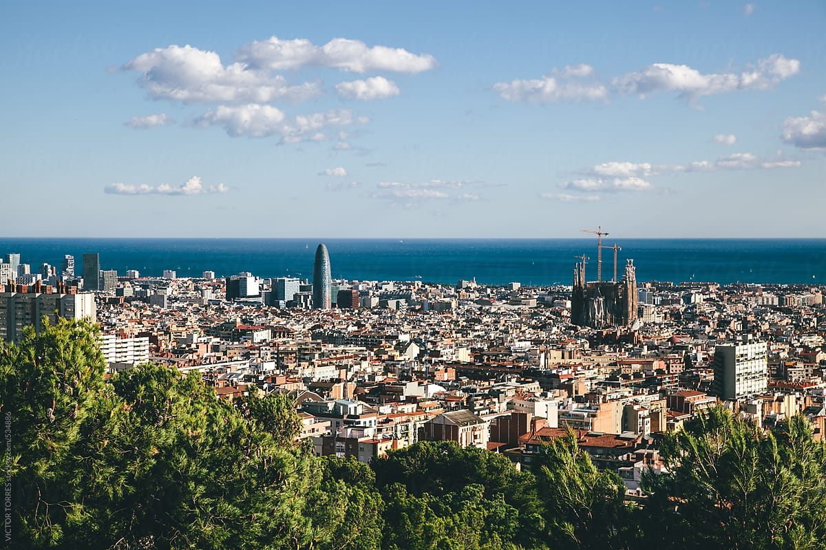 barcelona skyline with mediterranean sea by victor torres stocksy united barcelona skyline with mediterranean
