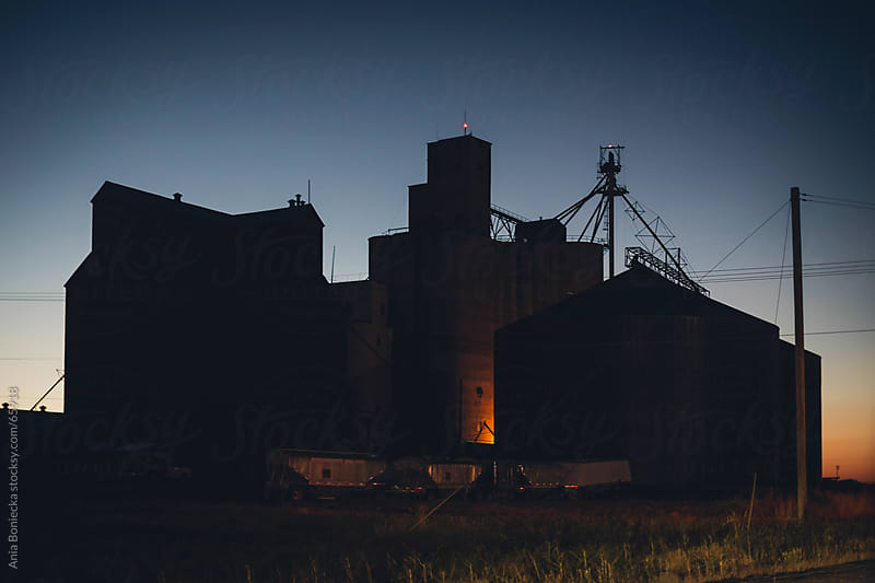 Building silhouette at dusk by Ania Boniecka for Stocksy United