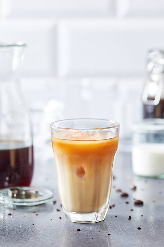 Cold brew coffee with milk by Martí Sans for Stocksy United