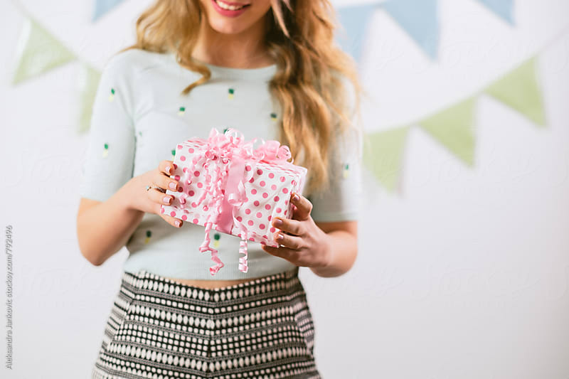 Close up of a Young Woman Holding a Present by Aleksandra Jankovic for Stocksy United