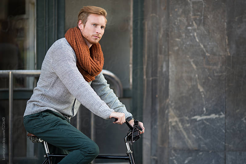 Ginger Man on a Bicycle by Lumina for Stocksy United