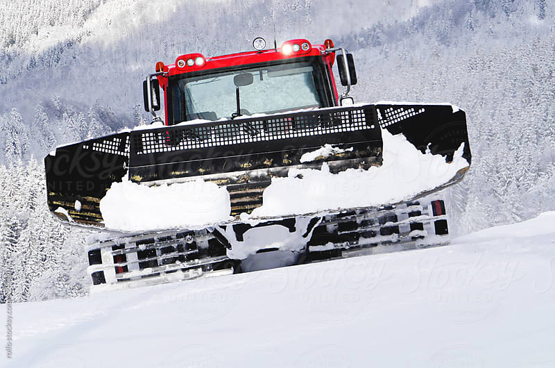 Snow crawler clearing snow by rolfo for Stocksy United
