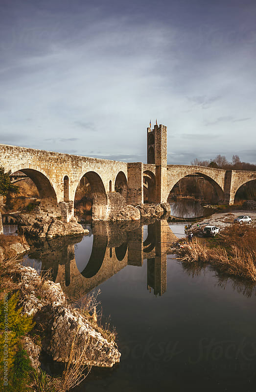 View of the medieval bridge and the river of Besalu. Girona, Spain. by BONNINSTUDIO for Stocksy United