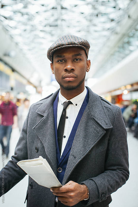 Portrait of Good-Looking Black Businessman in Bright Airport by Julien L. Balmer for Stocksy United