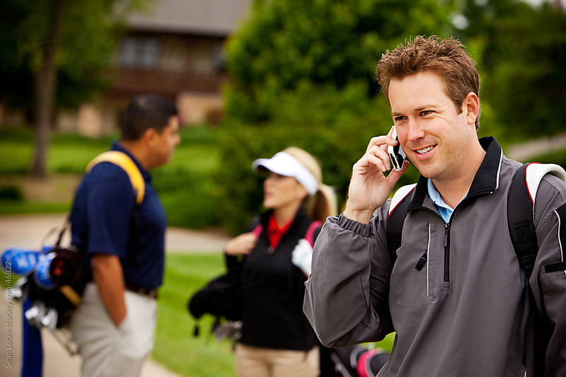 Golf: Man On the Phone Before Playing Round by Sean Locke for Stocksy United
