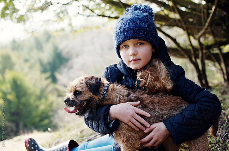 Little girl and her dog on a Winter walk by CHRISTINA K for Stocksy United
