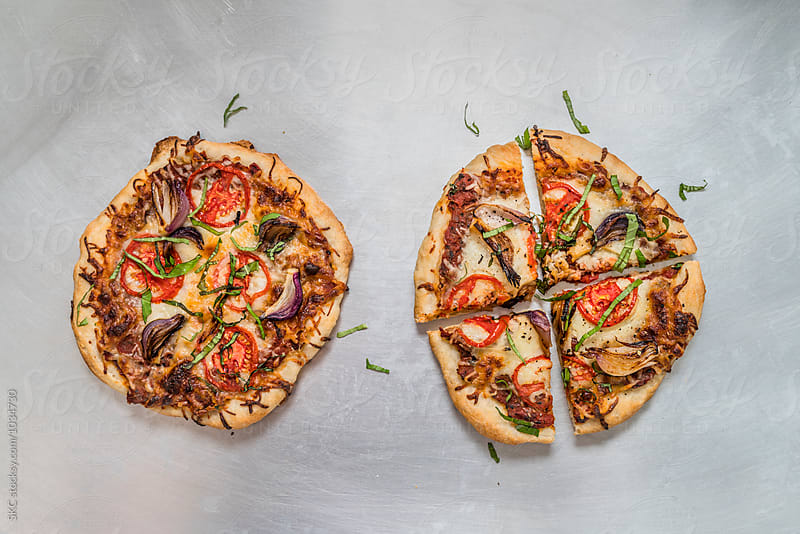 Rustic Tomato and Onion Pizza by suzanne clements for Stocksy United