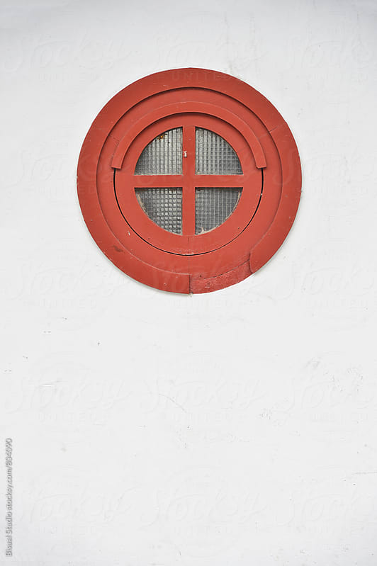 Red window on a white wall by Bisual Studio for Stocksy United