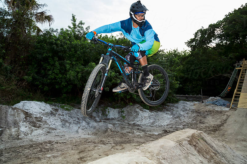 Mountain biker catching air by Adam Nixon for Stocksy United