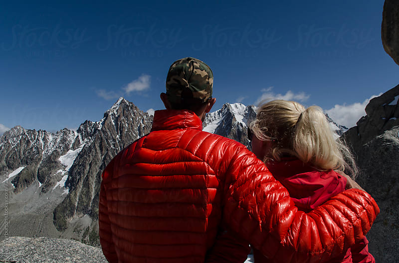 couple taking in the view of  the mountains by Neil Warburton for Stocksy United