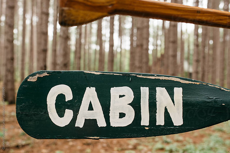 Cabin sign in a pine forest by Gabriel (Gabi) Bucataru for Stocksy United