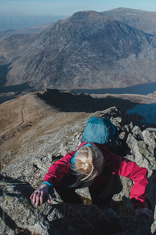 Young Woman Scrambling in the Mountains by Neil Warburton for Stocksy United