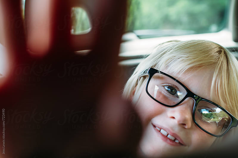smiling girl reaching at camera by Jess Lewis for Stocksy United