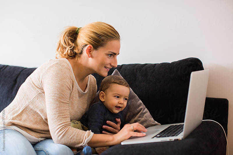Mother and Her Baby Boy Using Laptop by Mosuno for Stocksy United