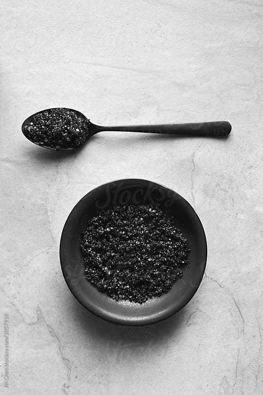 Black charcoal salt  by Jill Chen for Stocksy United