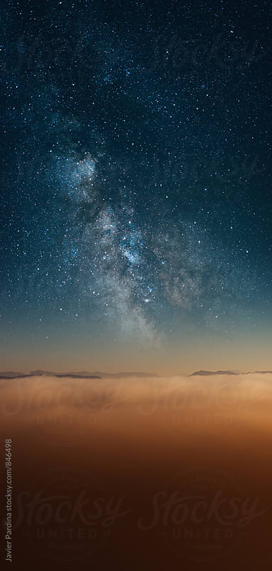 landscape with clouds at sunset and stars by Javier Pardina for Stocksy United